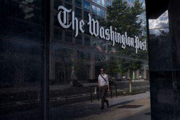 A man walks past The Washington Post on August 5, 2013 in Washington, DC.