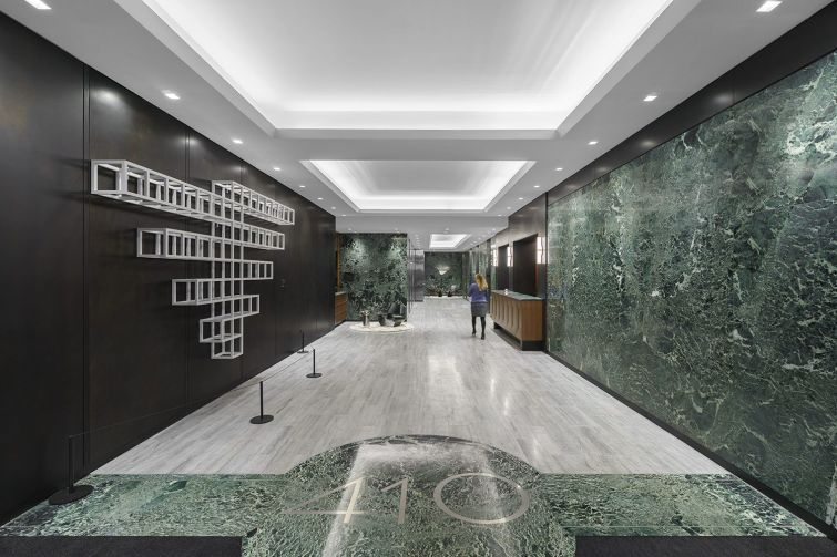 Global Holdings repurposed the existing green marble in the renovation of the lobby of 410 Park Avenue.