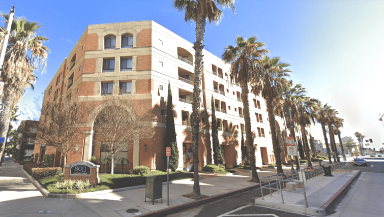 The five-story apartment community at 225 West 3rd Street is located near the I-710 Freeway, Long Beach Airport, and Cal State University Long Beach.