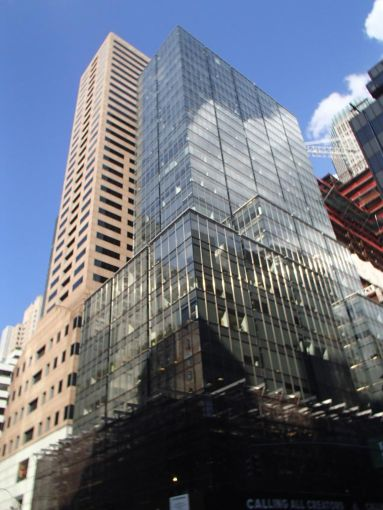 A tall, glass covered grey skyscraper at 565 Fifth Avenue.