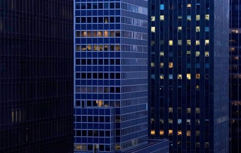 Largely empty office buildings with several floors dark.