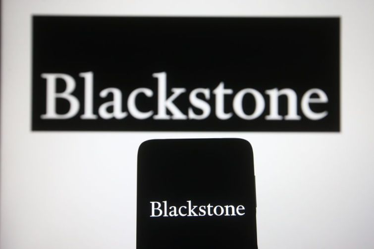 In this photo illustration, Blackstone Group Inc. logo of a