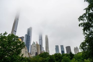 Fog hangs over skyscrapers in Central Park.