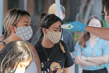 Fans get their temperature checked to support musical artist Blxst on Sept. 5, 2020, at Del Amo Fashion Center in Torrance, California.
