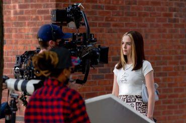 Zoey Deutch on set.