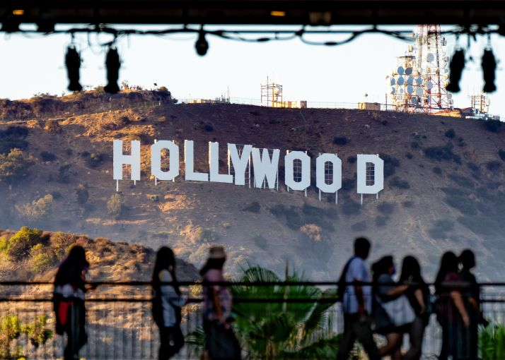 Shoppers passing by the Hollywood Sign at the Hollywood & Highland shopping center on July 19.