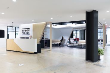 Avison Young's new office at 530 Fifth Avenue includes wood accents and exposed concrete floors.