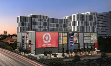 A large apartment complex with a target in front with a large red target sign.
