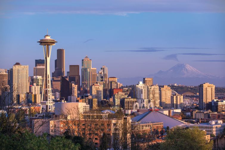 Seattle's iconic skyline with Mount Rainier in the distance.