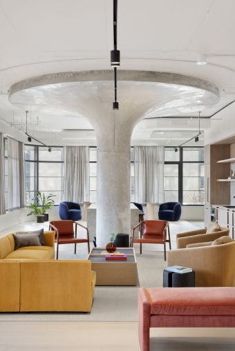 The designers at Fogarty Finger put in uplighting to highlight the building's large columns, which are a remnant of its history as a warehouse.
