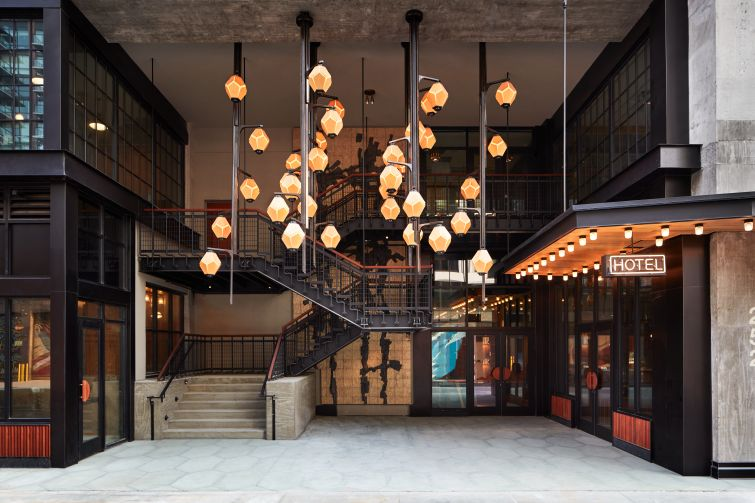 """The new Ace Brooklyn has lantern-like pendant lights and a two-level entrance with a neon """"Hotel"""" sign."""