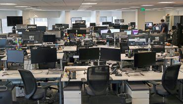 Empty rows of desks.