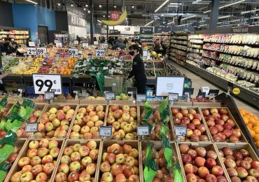 Employees stock the produce section at a newly opened Amazon Fresh store in California in October 2020.