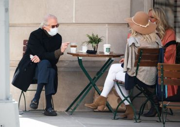 People wear face mask while dining outside a restaurant on the Upper East Side amid the coronavirus pandemic on March 23, 2021 in New York City.