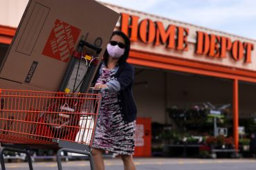 A shopper leaves a Home Depot with merchandise last month. Shares of Home Depot dropped more than 4 percent in the second quarter, although profits surpassed analysts expectations.