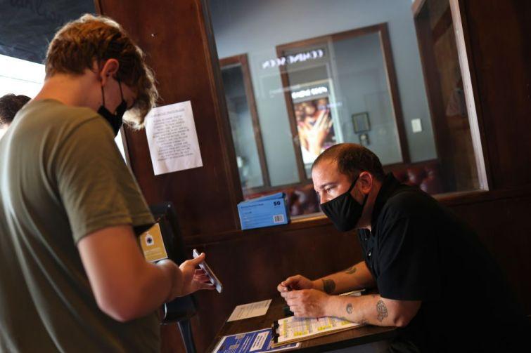 Employee checks a vaccination card