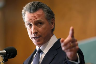 California Gov. Gavin Newsom speaks to union workers and volunteers on election day at the IBEW Local 6 union hall in San Francisco. The attempt to unseat and replace Newsom failed, with more than 64 percent voting to keep him in office.