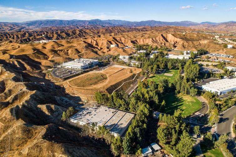 The industrial and life sciences business park spanning 118.5 acres was owned by funds managed by L.A.-based firms Oaktree Capital Management and Intertex Companies.