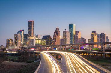 Houston, Texas, USA downtown city skyline and highway.