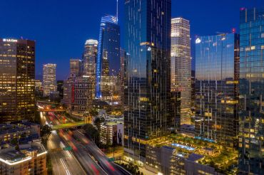 An aerial view shows increasing traffic on the Interstate 110 freeway near high-rise buildings.