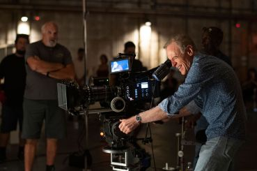US cinematographer Richard Crudo, right, assists interns as they shoot a scene during a session of the Academy Gold Production Track Program at Warner Bros Ranch in Burbank in 2019.