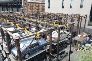 Cars stacked at a mechanical parking deck.