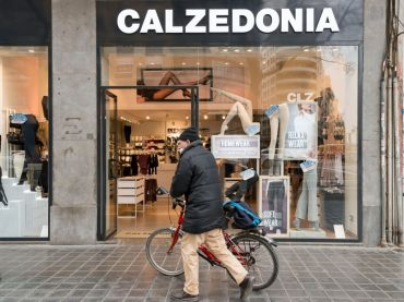 A man walks past the Calzedonia clothing store
